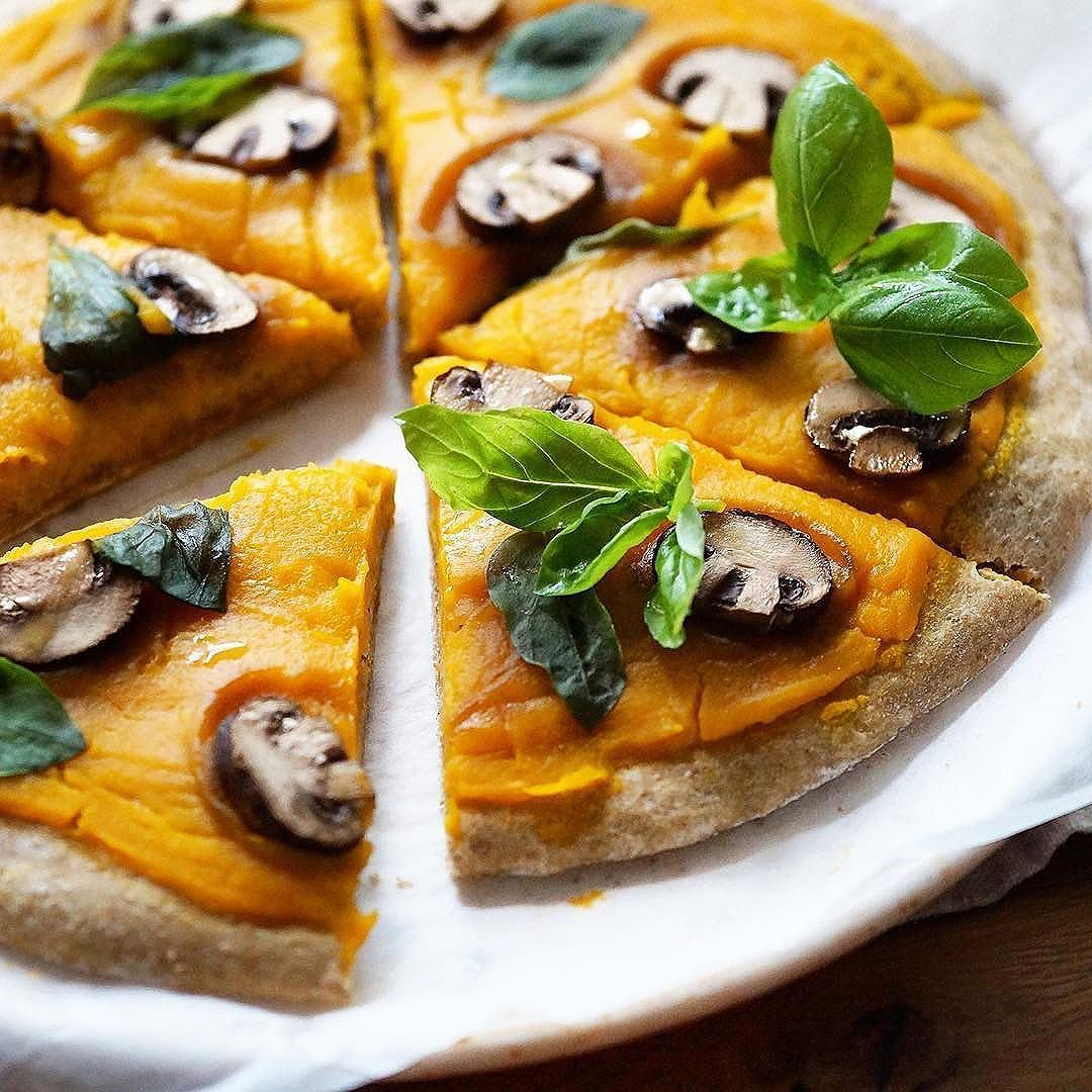 Basil and Butternut squash pizza by @kikaramelized Pizza base: 100gr spelt flour 35 gr whole wheat flour 1/4 tsp sea salt 1/4 tsp instant yeast 80ml warm water 1/2 tbsp olive oil combine flours salt and yeast in a big bowl add warm water gradually while mixing with hand, finally add olive oil and knead the dough until smooth. transfer to a slightly floured bowl and rest in warm room and let it doubled in size, about 1-2 hr. . . . Meanwhile prepare the butternut squash puree for topping 1 cup butternut squash, peeled, chop into chunks 1/3 tsp sea salt 1/4 cup water 4 button mushrooms 2-3 twigs of fresh basil Olive oil steam butternut squash until tender, about 7-10 mins transfer to blender, add salt and water, blend until smooth. Set aside . . . take out the dough from bowl, transfer to a slightly floured baking paper flatten the dough with rolling pin to 1/2-1 cm thick spread the butternut squash puree on top slice mushroom and arrange on top brush the top with olive oil Bake in 180C preheated oven for 25 mins take out from oven, arrange the basils slice eat repeat. .