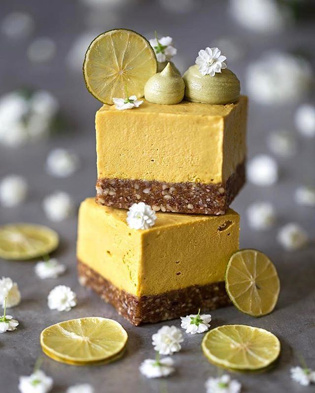 """MANGO RAW CHEEZECAKE by @datesandavocados INGREDIENTS FOR THE BASE: 1 cup raw almonds 1/2 cup dates, pitted and chopped 1 Tbsp cacao nibs 1 tsp cashew butter 1/4 tsp vanilla extract Pinch of salt INGREDIENTS FOR THE FILLING: 1 cup cashews, soaked for 6h Flesh of 1 mango (2 cups) 4 dates, pitted and chopped 1/2 tsp lemon juice 1 Tbsp maple syrup 1/4 tsp vanilla extract 3 Tbsp coconut oil, melted Pinch of salt METHOD: 1.In a food processor, process the nuts and the chopped dates together until broken down & combined. 2.Add the cacao nibs, cashew butter, vanilla extract, and salt and process a few times until combined. 3.Line a 8"""" square mold with parchment paper and press the dough evenly. Place into the freezer for 30 min until it firms up. 4.To prepare the cream filling, rinse the cashews and drain them well. 5.Blend all ingredients together (except coconut oil) in a high-speed blender until you reach a nice and smooth consistency. 6.Stream in melted coconut oil and blend until incorporated. 7.Pour the filling over the crust and freeze till set (at least 3 hours) 9.Remove from freezer approx. 1h before serving, cut into slices, and enjoy!"""