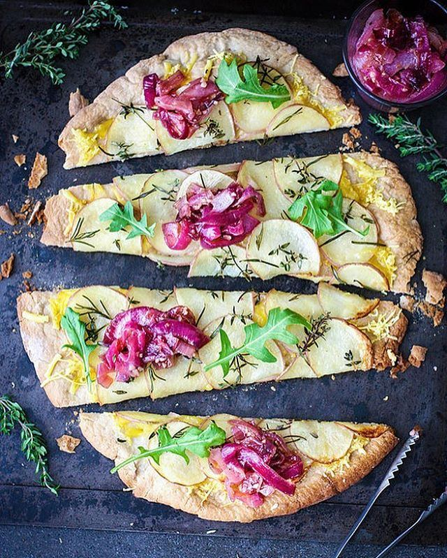 Vegan Salt and Vinegar Potato Pizza by @healthyeating_jo ? Recipe as posted on healthyeatingjo.com: (Serves 1-2) GF Pizza Crust 1 & 1/2 cups GF All Purpose Flour 1/2 tsp baking powder 1 Tbsp granulated stevia (or granulated sweetener of choice) 1 x 7g sachet of yeast 3/4 cup warm water 1/2 Tbsp olive oil 1/2 tsp pink himalayan salt Mix the yeast, water and stevia in a bowl, and leave for 5 minutes. Mix the flour and salt in a bowl, and add the prepared yeast mixture and oil. Combine together into a dough. Place the dough on a lightly floured surface and knead for 10 minutes until elastic. Place in a lightly oiled bowl, cover, and put in a warm place place for 30 minutes. Punch the dough and knead again. Roll out to desired shape and thickness and place on a lined baking tray. Cook at 240C for 10-15mins until lightly golden. Salt & Vinegar Caramelised Onions 1 red spanish onion sliced 1 clove of garlic crushed or 1 tsp crushed garlic 1 Tbsp granulated stevia (or natural sweetener of choice) 1 Tbsp red wine vinegar 1 tsp coconut oil 1/8tsp pink himalayan salt (to taste) Ground black pepper Melt the oil in a frypan and add the onion and garlic. Cook at Medium Low heat stirring for 30 minutes until the onions have softened. Add the stevia and vinegar and cook for another 10 minutes until thick and caramelised. Pizza Topping 50g grated vegan cheese (Could potentially sub with Nutritional Yeast flakes to taste) 134g red skinned potatoes thinly sliced (Approx 1-2 small potatoes) 1 tsp olive oil 1 Tbsp rosemary sprigs 1 Tbsp Thyme sprigs Pink Himalayan salt Rocket (Arugula) leaves Sprinkle baked pizza crusts with the grated cheese Arrange the potatoes in a thin layer slightly overlapping. The amount you use will depend on the size of your pizza base. Thin slices will ensure even cooking. Drizzle with the oil Sprinkle over the herbs and salt Cook for 15 minutes until golden brown Top cooked pizza with prepared caramelised onions and fresh rocket leaves.